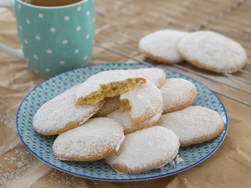 A plate full of easy gluten free vanilla and almond cookies