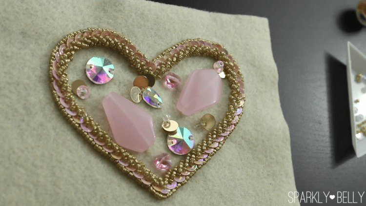Sew on medium size stones on DIY heart applique