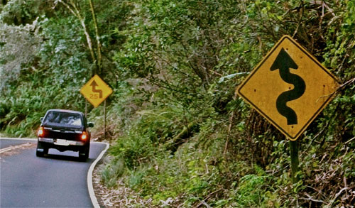 Winding road sign sparsely sage and timely winding road sign publicscrutiny Images