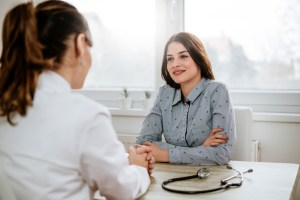 woman talking to doctor about her fibroids