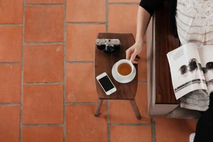 Lady Reading Magazine and Drinking Tea
