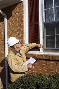 Home inspector inspecting exterior window