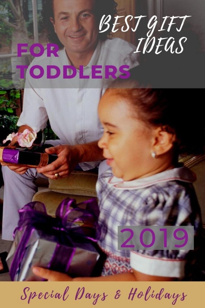 Best Toddler Gifts pin of little girl receiving a present - very purple