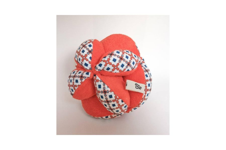 red Montessori sensory ball with flowers on it