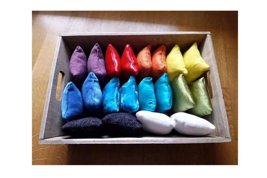 box with multi coloured cushions