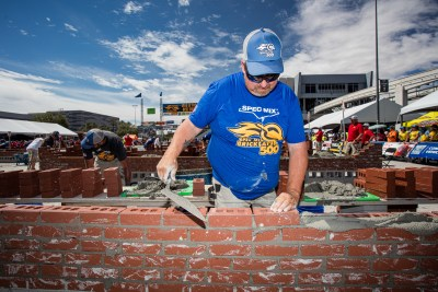 Fred Campbell laying brick on his wall