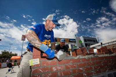 Zac Guire using all his skills to compete for the title of World's Best Bricklayer