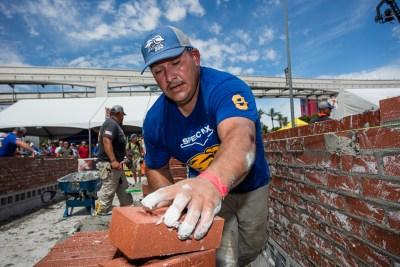 Mario Landeros reaching for a brick
