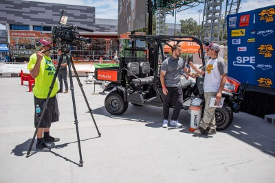 Tom Clark interviews a product specialist from Kubota during the SPEC MIX BRICKLAYER 500