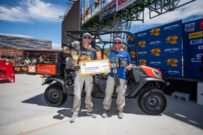 Darian Douthit and Nigel Delmez posing with a new Kubota RTV-X1140 after winning the top craftsman award at the 2021 SPEC MIX BRICKLAYER 500