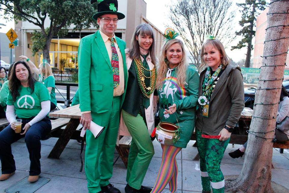 5 People dressed in green and shamrocks for St. Patricks day