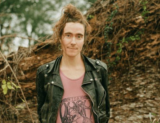 A photo of Nikita Shepard, a research fellow focusing on the history of queer youth at the Don Kelly Research Collection of Gay Literature and Culture at Texas A&M University