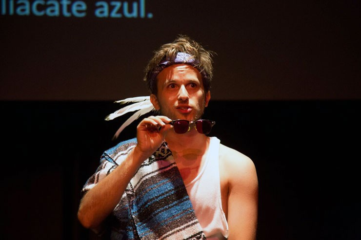 A photo of Josh Inocéncio performing Purple Eyes at Sin Muros Latino Theatre Festival.