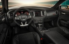 The race-inspired interior of the Dodge Charger SRT Hellcat Widebody features a standard, leather-wrapped SRT flat-bottom steering wheel with mounted controls and paddle shifters, and standard French live-stitch accents throughout the instrument panel and doors