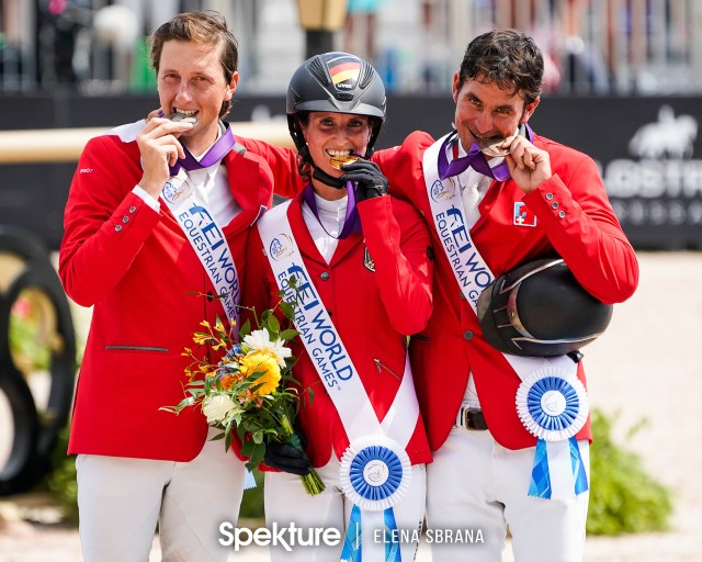 Earchphoto - Simone Blum, Martin Fuchs, and Steve Guerdat on the individual show jumping podium at the 2018 World Equestrian Games in Tryon NC