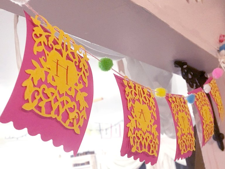 A Happy Celebration Bunting by Sharyn Sowell for Spellbinders using Heart Leaves dies