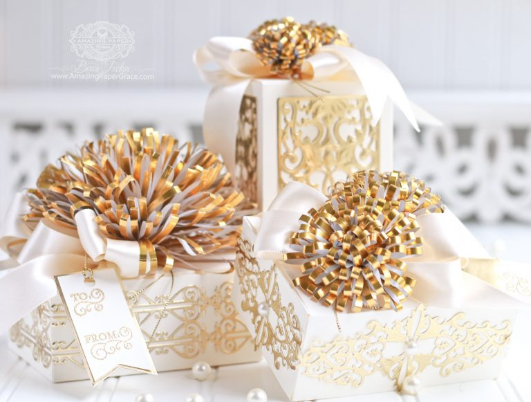 Luxe Gifts with Easy to Make Pom Pom Embellishment by Becca Feeken for Spellbinders usingS4-049 Loopy Roll Flowers,S6-124 Mini Card/Booklet Gift Box,SR-106 Giving Makes You Happy - Gift Box,S4-768 Swirls Strip Die,S4-767 Classic Twirling Vines, and S4-644 Botanical Box Inserts #spellbinders #diecutting #gifts