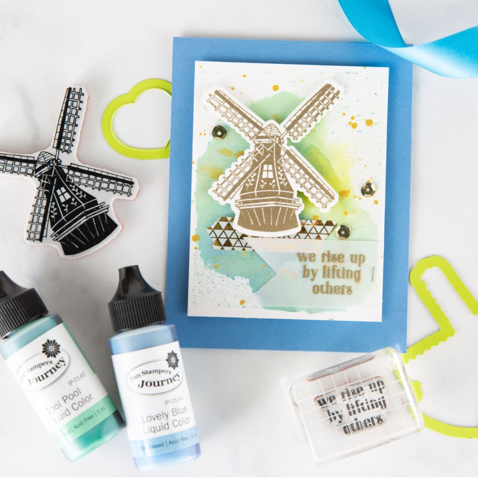 We Rise By Lifting Others, handmade card idea with Fun Stampers Journey March Stamp of the Month, Good Places. Embossed gold windmill and watercolor background are elegant for an encouragement card.