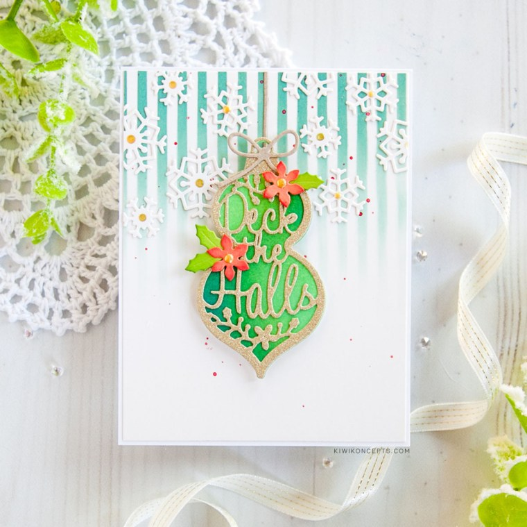"Spellbinders Die D-Lites Holiday 2019 Inspiration | Clean & Simple Christmas Cards with Keeway Tsao. Keeway says: ""This card showcases the Die D-Lites Deck The Halls dies. I die cut the ornament twice, one out of white card stock and the second one out of gold glitter card stock. The second one also was die cut again to cut out the words 'deck the halls' leaving you with an intricate frame."""