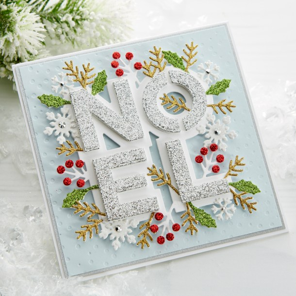 S4-1062 Festive Noel: Get in the holiday spirit with this layered Noel die set. A gorgeous mix of holiday foliage and snowflakes, you (almost) won't want to share this card when it's finished! What's New | Spellbinders Sparkling Christmas Collection #Spellbinders #NeverStopMaking #DieCutting #Cardmaking #GlimmerHotFoilSystem #Christmas