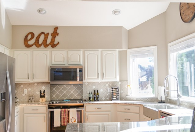 kitchen, white cabinets, granite countertops, stainless appliances, bright