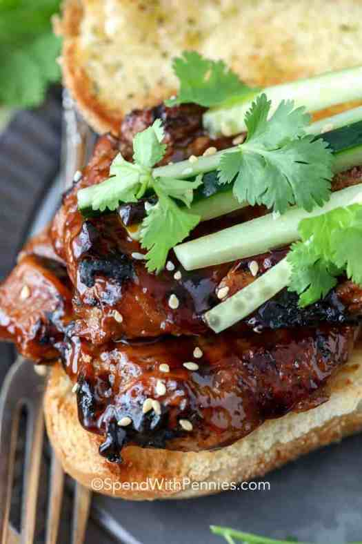Grilled Pork Teriyaki Sandwich on a toasted roll with cucumbers and cilantro