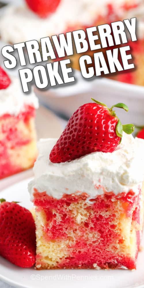 A slice of strawberry poke cake topped with a strawberry with writing