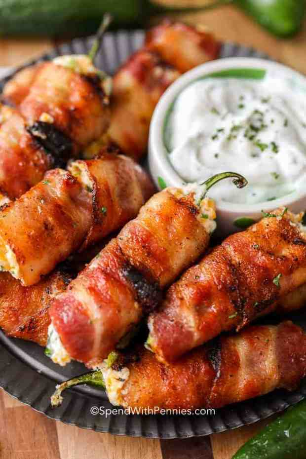 A plate of bacon wrapped jalapeno poppers off the grill