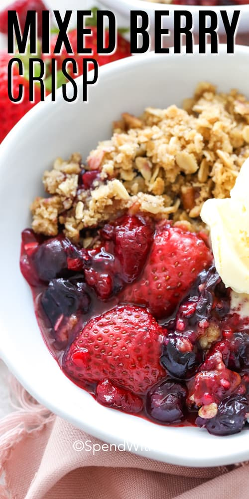 Berry Crisp in a white bowl with a scoop of ice cream.