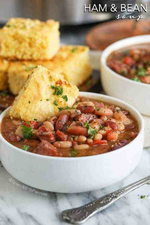 """Slow Cooker Ham and Bean Soup is the perfect hearty meal to come home to on a chilly day. This """"no-soaking required"""" and just minutes to prepare, this recipe cooks effortlessly in your Crock Pot all day long! Dinner is ready when you are!"""