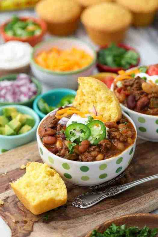 Slow Cooker bean Chili in polka dotted bowl with corn bread