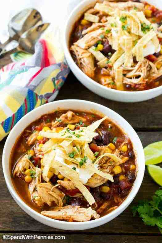 Bowls of easy Chicken Enchilada Soup loaded with beans and veggies