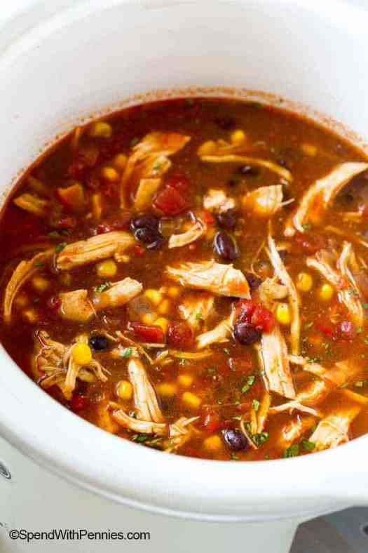 Chicken enchilada soup  in the crock pot slow cooker ready to serve.