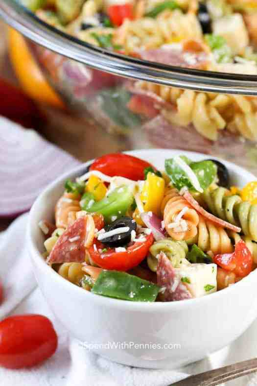 A small serving of colorful Italian Pasta salad ready for a potluck!