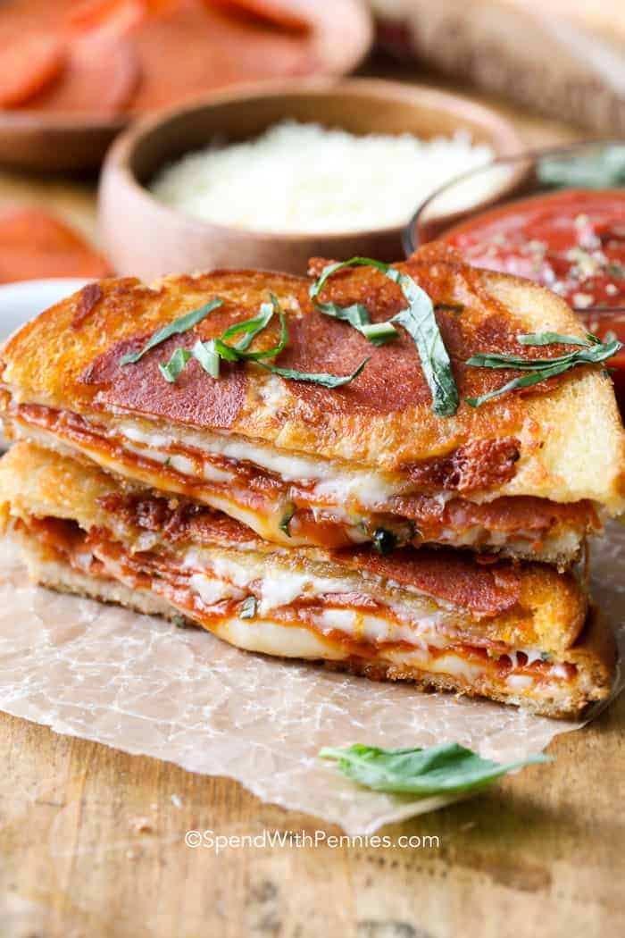 Mozzarella and pepperoni grilled cheese sandwich with basil.
