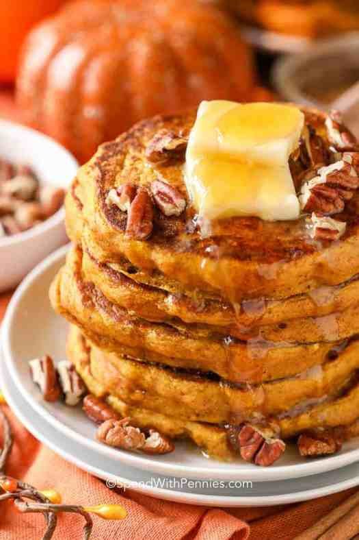 Pumpkin pancakes are topped with butter, syrup and pecans.