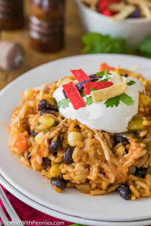 A place of salsa chicken casserole topped with sour cream, cilantro, and sour cream.