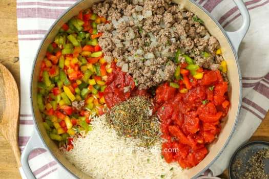 Overview of stuffed pepper ingredients in the casserole dish.