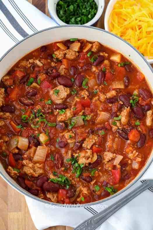 Delicious turkey chili ready to serve topped with fresh parsley.