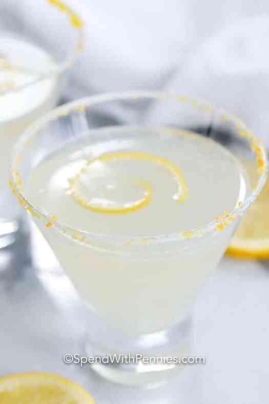 Lemon drop martini garnished with a lemon rind.