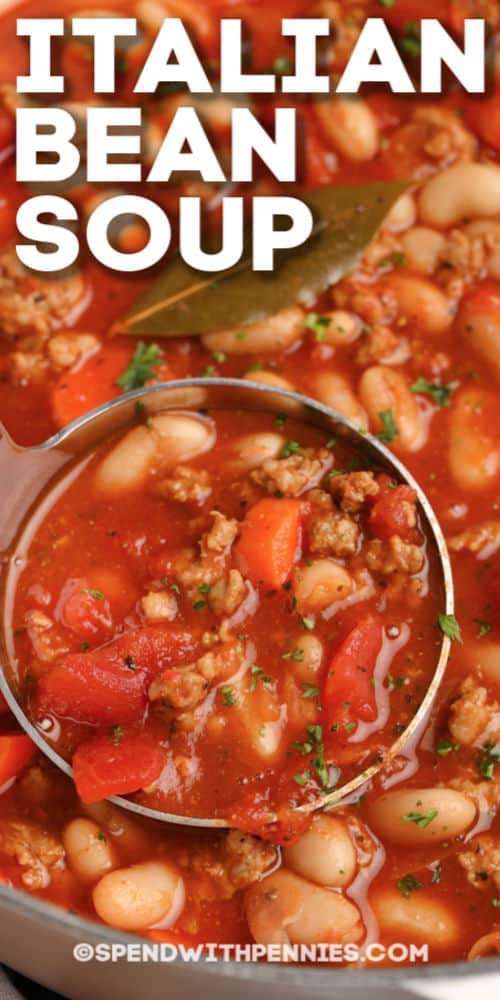 Italian bean soup with a bay leaf being served with writing