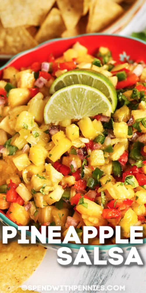 Pineapple Salsa with two lime wedge and writing ontop