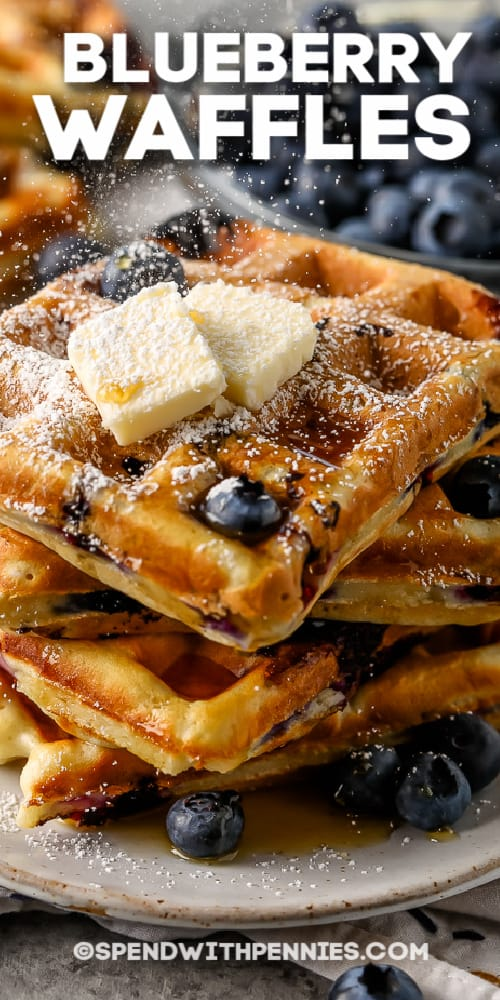 Blueberry Waffles with butter and syrup and a title