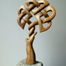 Celtic knotwork tree carved from whisky barrel stave