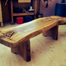 Garden bench with carved Celtic triquetra in Wych elm