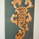 Celtic scorpion carved in lime on slate background
