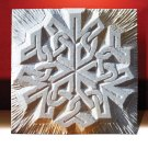 Celtic knotwork snowflake carved in white stone