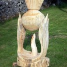 Stylised thistle carved from Scots pine