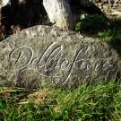 hand-carved lettering stone burial ground sign Delliefure