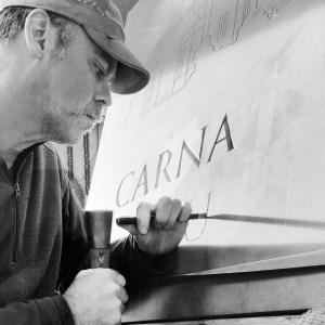 A photo of Scottish sculptor, Stuart Murdoch in his studio workshop
